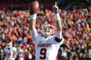 Quarterback Trevor Knight #9 of the Oklahoma Sooners celebrates after scoring a touchdown in the first half of play against the Iowa State Cyclones at Jack Trice Stadium on November 1, 2014 in Ames, Iowa.