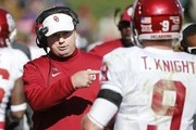 Head coach Bob Stoops of the Oklahoma Sooners coaches quarterback Trevor Knight #9 of the Oklahoma Sooners on the sidelines in the first half of play against the Iowa State Cyclones at Jack Trice Stadium on November 1, 2014 in Ames, Iowa.