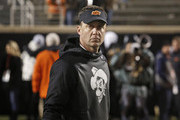 Head Coach Mike Gundy of the Oklahoma State Cowboys waits for his players to leave the field after the game against the Oklahoma Sooners November 28, 2015 at Boone Pickens Stadium in Stillwater, Oklahoma. Oklahoma defeated Oklahoma State 58-23.