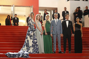 """(L-R) Taylor Hill, Lola Winding Refn, Liv Corfiven, Nicolas Winding Refn, Miles Teller and his girlfriend Keleigh Sperry attend the screening of """"Too Old To Die Young"""" during the 72nd annual Cannes Film Festival on May 17, 2019 in Cannes, France."""
