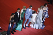"Keleigh Sperry, Miles Teller, Liv Corfixen, Nicolas Winding Refn, Lola Winding Refn and Taylor Hill attend the screening of ""Too Old To Die Young"" during the 72nd annual Cannes Film Festival on May 17, 2019 in Cannes, France."
