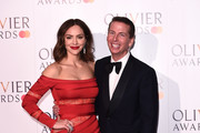 Katharine McPhee and Jack McBrayer pose in the press room during The Olivier Awards with Mastercard at the Royal Albert Hall on April 07, 2019 in London, England.