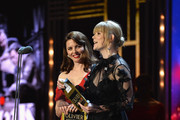 Ophelia Lovibond (L) and Hannah Arterton present the award for Best Set Design on stage during The Olivier Awards with Mastercard at Royal Albert Hall on April 8, 2018 in London, England.