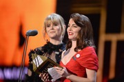 Ophelia Lovibond (R) and Hannah Arterton present the award for Best Lighting Design on stage during The Olivier Awards with Mastercard at Royal Albert Hall on April 8, 2018 in London, England.