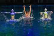 "Olympian Ryan Lochte (C) performs in the pool at the ""O"" theater with ""O by Cirque du Soleil"" performers Nayara Figueira (L) and Christina Jones (R) as Lochte and dancer Cheryl Burke (not pictured) rehearse for their ""Dancing with the Stars"" performance with the cast of ""O"" at the Bellagio on September 30, 2016 in Las Vegas, Nevada."