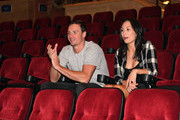 """Olympian Ryan Lochte (L) and dancer Cheryl Burke watch a private performance of """"O by Cirque du Soleil"""" during a rehearsal for their """"Dancing with the Stars"""" performance with the cast of """"O"""" at the Bellagio on September 30, 2016 in Las Vegas, Nevada."""