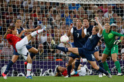 Azusa Iwashimizu #3 of Japan attempts a shot against Carli Lloyd #10, Shannon Boxx #7, Rachel Buehler #16, Abby Wambach #14, and Hope Solo #1 of the United States during the Women's Football gold medal match on Day 13 of the London 2012 Olympic Games at Wembley Stadium on August 9, 2012 in London, England.