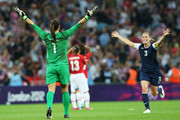 Hope Solo #1 and Christie Rampone #3 of the United States celebrate after defeating Japan by a score of 2-1 to win the Women's Football gold medal match on Day 13 of the London 2012 Olympic Games at Wembley Stadium on August 9, 2012 in London, England.