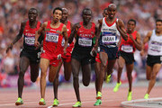 Isiah Kiplangat Koech of Kenya, Abdalaati Iguider of Morocco, Thomas Pkemei Longosiwa of Kenya and Mohamed Farah of Great Britain competes in the Men's 5000m Final on Day 15 of the London 2012 Olympic Games at Olympic Stadium on August 11, 2012 in London, England.