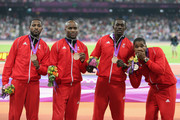 Bronze medalists Keston Bledman, Marc Burns, Emmanuel Callender and Richard Thompson of Trinidad and Tobago celebrate on the podium during the medal ceremony for the Men's 4 x 100m Relay Final on Day 15 of the London 2012 Olympic Games at Olympic Stadium on August 11, 2012 in London, England.