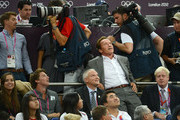 Patrick Schwarzenegger (2nd L), Arnold Schwarzenegger (2nd R) and London Mayor Boris Johnson (R) during the Men's Basketball gold medal game between the United States and Spain on Day 16 of the London 2012 Olympics Games at North Greenwich Arena on August 12, 2012 in London, England.