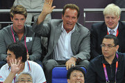 (L-R) Patrick Schwarzenegger, Arnold Schwarzenegger and London Mayor Boris Johnson during the Men's Basketball gold medal game between the United States and Spain on Day 16 of the London 2012 Olympics Games at North Greenwich Arena on August 12, 2012 in London, England.