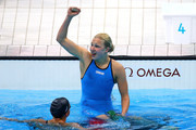 Ruta Meilutyte (R) of Lithuania celebrates after she won the Final of the Women's 100m Breaststroke as Rebecca Soni of the United States looks on on Day 3 of the London 2012 Olympic Games at the Aquatics Centre on July 30, 2012 in London, England.