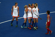 Ellen Hoog (C) of the Netherlands is congratulated by team-mates after scoring their second goal during the Women's Hockey Match between the Netherlands and Japan on day 4 of the London 2012 Olympic Games at Hockey Centre on July 31, 2012 in London, England.