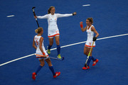 Ellen Hoog (R) of the Netherlands is congratulated by team-mates Carlien Dirkse van den Heuvel (L) and Marilyn Agliotti after scoring their second goal during the Women's Hockey Match between the Netherlands and Japan on day 4 of the London 2012 Olympic Games at Hockey Centre on July 31, 2012 in London, England.