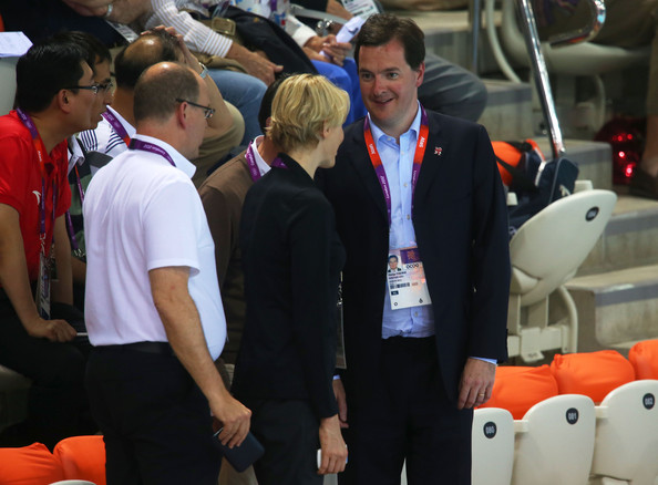 British Chancellor of The Exchequer George Osborne (R) chats with Princess Charlene (C) and Prince Albert II of Monaco during the evening session on Day 5 of the London 2012 Olympic Games at the Aquatics Centre on August 1, 2012 in London, England.