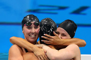 Shannon Vreeland. (L), Missy Franklin (R), Allison Schmitt (C) and Dana Vollmer of the United States celebrate after they won the Final of the Women's 4x200m Freestyle Relay on Day 5 of the London 2012 Olympic Games at the Aquatics Centre on August 1, 2012 in London, England.
