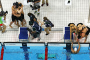 (At left) Shannon Vreeland, Missy Franklin, Allison Schmitt and Dana Vollmer of the United States celebrate next to team Australia after the UNited States won the Final of the Women's 4x200m Freestyle Relay on Day 5 of the London 2012 Olympic Games at the Aquatics Centre on August 1, 2012 in London, England.
