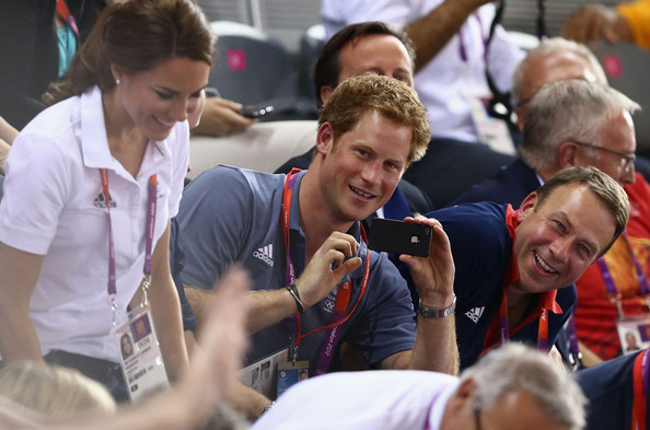 Prince Harry next to Catherine, Duchess of Cambridge as they watch the track cycling on Day 6 of the London 2012 Olympic Games at Velodrome on August 2, 2012 in London, England.