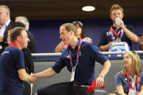 Prince William, Duke of Cambridge shakes hands with Andy Hunt, Chef de Mission for Great Britain as he takes his seat to watch the track cycling on Day 6 of the London 2012 Olympic Games at Velodrome on August 2, 2012 in London, England.