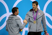 Gold medallist Michael Phelps (R) of the United States shakes hands with Silver medallist Ryan Lochte of the United States on the podium during the medal ceremony for the Men's 200m Individual Medley final on Day 6 nof the London 2012 Olympic Games at the Aquatics Centre on August 2, 2012 in London, England.