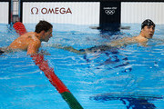 Gold medallist Michael Phelps (R) of the United States leaves the pool along with silver medallist Ryan Lochte (L) of the United States following the Men's 200m Individual Medley final on Day 6 of the London 2012 Olympic Games at the Aquatics Centre on August 2, 2012 in London, England.