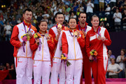 (L-R) Silver medallists Chen Xu and Jin Ma of China, Gold medallists Nan Zhang and Yunlei Zhao of China and Bronze medallists Joachim Fischer and Christinna Pedersen of Denmark in the Mixed Doubles Badminton medal ceremony on Day 7 of the London 2012 Olympic Games at Wembley Arena on August 3, 2012 in London, England.
