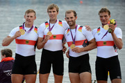 Tim Grohmann, Lauritz Schoof, Phillipp Wende and Karl Schulze of Germany celebrate with their gold medals during the medal ceremony for the Men's Quadruple Sculls final on Day 7 of the London 2012 Olympic Games at Eton Dorney on August 3, 2012 in Windsor, England.
