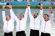 Tim Grohmann, Lauritz Schoof, Phillipp Wende and Karl Schulze of Germany celebrate before receiving their gold medals during the medal ceremony for the Men's Quadruple Sculls final on Day 7 of the London 2012 Olympic Games at Eton Dorney on August 3, 2012 in Windsor, England.