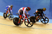 Azizulhasni Awang (R) of Malaysia wins ahead of  Hersony Canelon (L) of Venezuela, and Seiichiro Nakagawa of Japan (C)  in the Men's Sprint Track Cycling 1/8 Final Repechages on Day 8 of the London 2012 Olympic Games at Velodrome on August 4, 2012 in London, England.