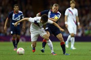 Sukyoung Yun of Korea holds off Craig Bellamy of Great Britain during the Men's Football Quarter Final match between  Great Britain and Korea, on Day 8 of the London 2012 Olympic Games at Millennium Stadium on August 4, 2012 in Cardiff, Wales.