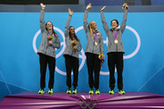 Gold medallists (L-R) Missy Franklin, Rebecca Soni, Dana Volmer, and Allison Schmitt of the United States aknowledge the crowd from the podium during the medal ceremony for the Women's 4x100m Meldey Relay Final on Day 8 of the London 2012 Olympic Games at the Aquatics Centre on August 4, 2012 in London, England.