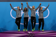 Gold medallists (L-R) Missy Franklin, Rebecca Soni, Dana Volmer, and Allison Schmitt of the United States celebrates on the podium during the medal ceremony for the Women's 4x100m medley Relay Final on Day 8 of the London 2012 Olympic Games at the Aquatics Centre on August 4, 2012 in London, England.