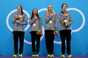 Gold medallists (L-R) Missy Franklin, Rebecca Soni, Dana Volmer, and Allison Schmitt of the United States pose on the podium during national anthem in the medal ceremony for the Women's 4x100m medley Relay Final on Day 8 of the London 2012 Olympic Games at the Aquatics Centre on August 4, 2012 in London, England.