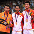 Lin Dan Chong Wei Lee Photos - Lin Dan of China celebrates with his Gold medal on the podium, Chong Wei Lee of Malaysia (L) the Silver and Long Chen of China (R) the Bronze, following the Men's Singles Badminton Gold Medal match on Day 9 of the London 2012 Olympic Games at Wembley Arena on August 5, 2012 in London, England. - Olympics Day 9 - Badminton