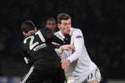 Gareth Bale of Spurs battles with Maxime Gonalons of Olympique Lyonnais during the UEFA Europa League Round of 32, second leg match between Olympique Lyonnais and Tottenham Hotspur FC at Stade de Gerland on February 21, 2013 in Lyon, France.