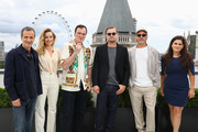 (L-R)  David Heyman, Margot Robbie, Quentin Tarantino, Leonardo DiCaprio, Brad Pitt and Shannon Macintosh attend the Once Upon A Time…In Hollywood Photocall in London at The Corinthia Hotel on July 31, 2019 in London, England.