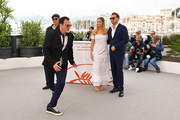 """Director Quentin Tarantino, Brad Pitt, Margot Robbie and Leonardo DiCaprio attend thephotocall for """"Once Upon A Time In Hollywood""""  during the 72nd annual Cannes Film Festival on May 22, 2019 in Cannes, France."""