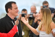 """Director Quentin Tarantino and Margot Robbie attend thephotocall for """"Once Upon A Time In Hollywood""""  during the 72nd annual Cannes Film Festival on May 22, 2019 in Cannes, France."""