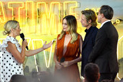 "Host Edith Bowman speaks to Margot Robbie, Brad Pitt and Leonardo DiCaprio as they attend the ""Once Upon a Time... in Hollywood"" UK Premiere at the Odeon Luxe Leicester Square on July 30, 2019 in London, England."