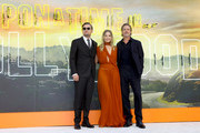 (L-R)  Leonardo DiCaprio, Margot Robbie and Brad Pitt attend the UK Premiere of 'Once Upon A Time In Hollywood' at Odeon Luxe Leicester Square on July 30, 2019 in London, England.