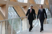 "Former US secretary of state John Kerry (L) and French Minister of Economy and Finance Bruno Le Maire walk during the One Planet Summit on December 12, 2017 at La Seine Musicale venue on l'ile Seguin in Boulogne-Billancourt, west of Paris..?The French President hosts 50 world leaders for the ""One Planet Summit"", hoping to jump-start the transition to a greener economy two years after the historic Paris agreement to limit climate change. / AFP PHOTO / LUDOVIC MARIN"
