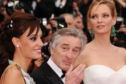 (L-R) Jury Memebers Martina Gusman,  Robert de Niro and Uma Thurman attend the Opening Ceremony at the Palais des Festivals during the 64th Cannes Film Festival on May 11, 2011 in Cannes, France.