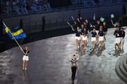 Flag bearer and wrestler, Sofia Mattsson of Sweden leads her team into the stadium during the Opening Ceremony for the Baku 2015 European Games at the Olympic Stadium on June 12, 2015 in Baku, Azerbaijan.