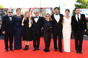 (L-R) Renato Berta, Martina Gedek, Andrea Arnold, Ryuichi Sakamoto, Carrie Fisher, Jiang Wen, Virginie Ledoyen and Pablo Larrain attend the Opening Ceremony And 'Gravity' Premiere during the 70th Venice International Film Festival at the Palazzo del Cinema on August 28, 2013 in Venice, Italy.