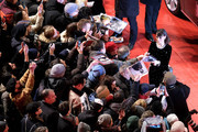 """Member of the International Jury Berenice Bejo signs autographes when arriving for the opening ceremony and """"My Salinger Year"""" premiere during the 70th Berlinale International Film Festival Berlin at Berlinale Palace on February 20, 2020 in Berlin, Germany."""