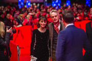 """President of the International Jury Jeremy Irons (R) and jury member Berenice Bejo arrive for the opening ceremony and """"My Salinger Year"""" premiere during the 70th Berlinale International Film Festival Berlin at Berlinale Palace on February 20, 2020 in Berlin, Germany."""