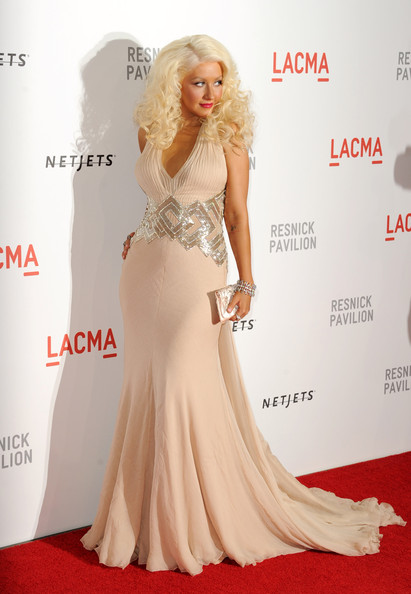 "Singer Christina Aguilera arrives at the opening Gala and ""Unmasking"" for the Resnick Pavilion at LACMA on September 25, 2010 in Los Angeles, California."