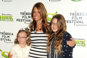 """TV personality Kelly Bensimon (C) with daughters Thaddeus Ann Bensimon (L) and Sea Louise Bensimon (R) at the 2010 Tribeca Film Festival opening night premiere of """"Shrek Forever After"""" at the Ziegfeld Theatre on April 21, 2010 in New York City."""