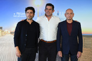 """Chris Weitz, Oscar Isaac and Sir Ben Kingsley attend a photocall for """"Operation Finale"""" on September 8, 2018 in Deauville, France."""